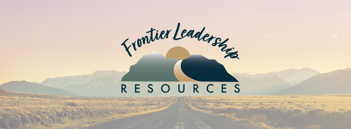 highway leading into mountains with Frontier Leadership logo in the center